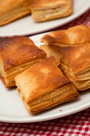 puff pastry: Bread puff pastry on a plate on a kitchen table