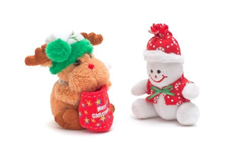Smiling snowman and reindeer toys dressed in scarf and cap photo