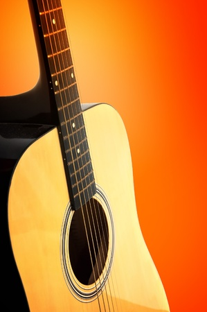guitar tuner: Detail of an yellow, wooden acoustic guitar over a white background Stock Photo