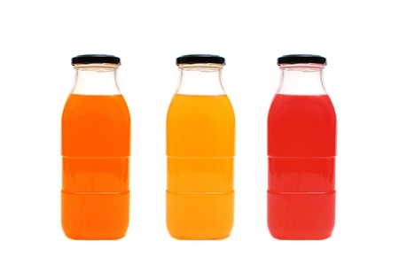 Glass bottles of juice on a white background photo