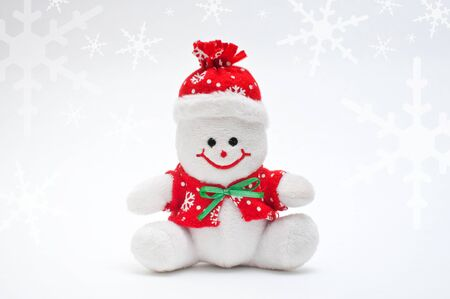 Smiling snowman toy dressed in scarf and cap Stock Photo - 11597024