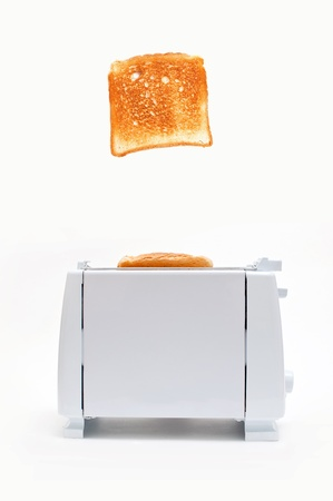 toaster: Bread Toasting device over a white background, toasted bread popping out of the device Stock Photo