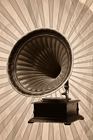 gramophone: gramophone with horn speaker for playing music over a grungy background with light rays