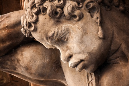 greek god: huge male head carved in stone, detail from Prague Stock Photo