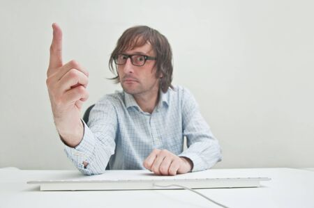 Businessman warning with his index finger Stock Photo - 11808074