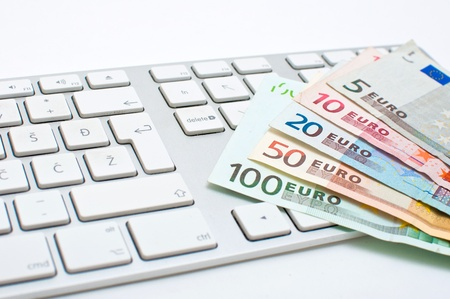 Office desktop, a computer keyboard and couple of euro bills. Stock Photo - 11808092