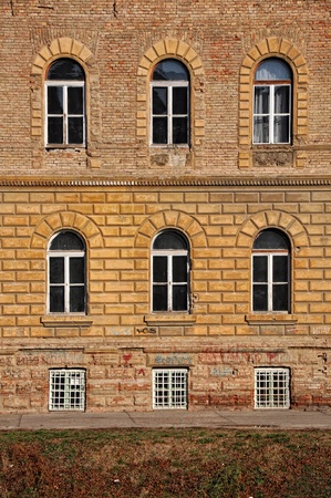 VArious windows on an old yellow building Stock Photo - 11929202