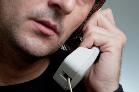 Close up image of a casual caucasian male talking on the phone. Stock Photo - 12064313