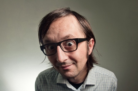 Big head nerd male close up portrait, this image is a humorous concept photo. Stock Photo - 12070248