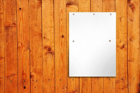 Blank white poster on a wooden wall photo