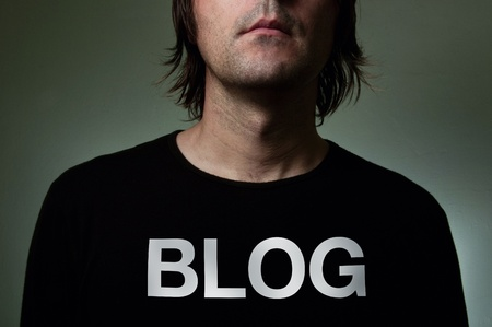Artistic portrait of a blogger with hiddenidentity in a black shirt with a big title BLOG on his chest. photo
