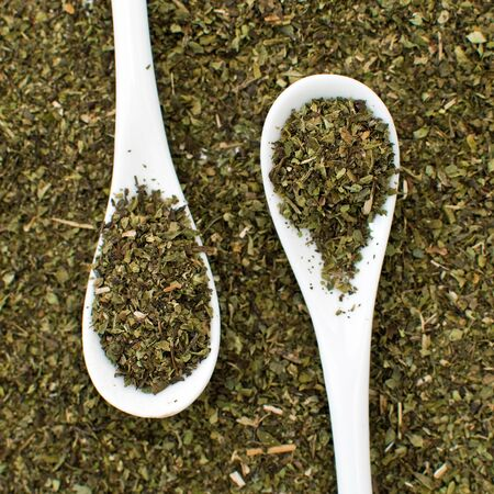Oregano spice on a spoon. photo
