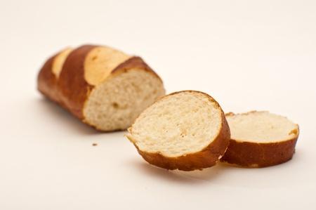 lye: Sliced lye stick, bavarian bread over a white background