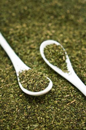oregano plant: Oregano spice on a spoon.