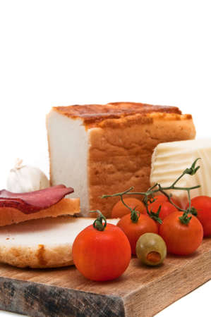Gluten free bread with olive, red cherry tomato, garlic, cheese and sliced red smoked meat. Stock Photo - 12329674