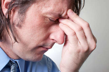 Adult businessman with a terrible headache, painful grimace. Stock Photo - 12329683