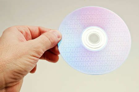 hand holding a dvd disc Stock Photo - 12751786