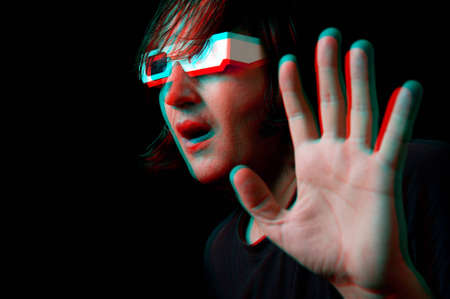 Scared man with anaglyph glasses watching a 3D movie, anaglyph image Stock Photo - 12684417