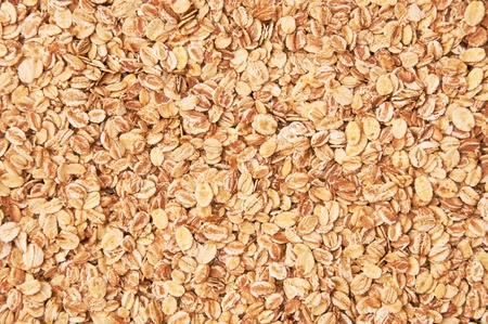 Texture of the yellow and white oat flakes photo