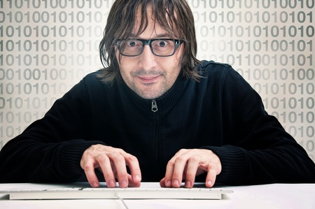 Man is typing on computer keyboard, computer hacker concept photo
