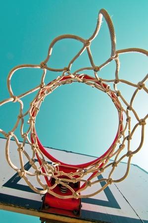 high school basketball: Basketball hoop against the warm summer sky. Stock Photo