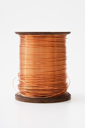 Copper wire rolled up on a spool photo