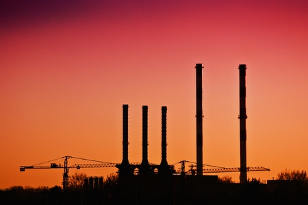 Heating plant chimneys against the sky Stock Photo - 12752369