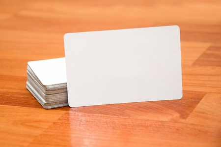 Stack of business cards with rounded corners over a white background photo
