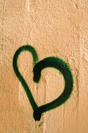 vandalize: Heart shaped grafitti on a street wall