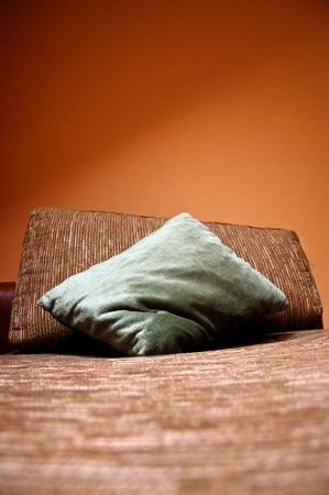 Green furniture cushion on a bed Stock Photo - 12916406