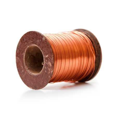 electrical wire: Copper wire rolled up on a spool Stock Photo