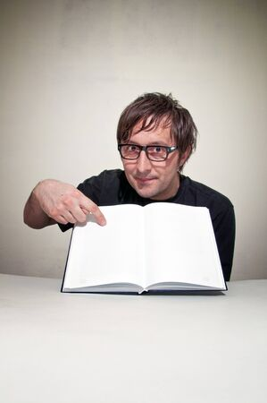 Casual men in black shirt is reading a book. photo