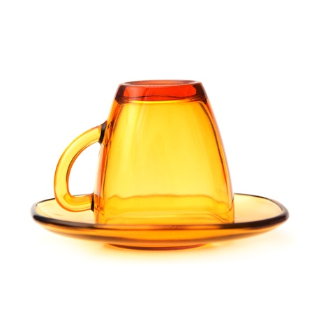 yelllow: yelllow glass tea cup against the white background