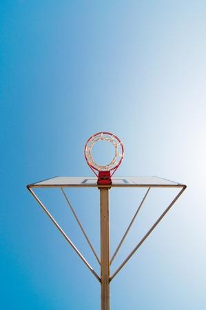 high school basketball: Basketball hoop against the warm summer sky