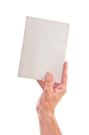 Hand holding a book with blank covers, over a white background Stock Photo - 13119258