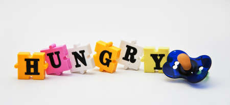 Colorful word puzzle spelling word  Hungry  photo