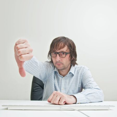 Casually dressed business man showing thumb down gesture. Stock Photo - 13119291