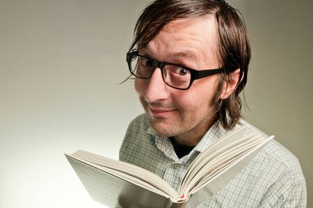 Nerd male holding a book with empty white covers, this image is a humorous concept photo. photo