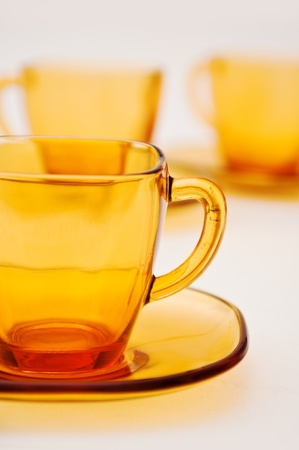 yelllow glass tea cups against the white background Stock Photo - 13119307