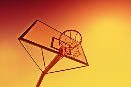 Basketball hoop against the warm summer sky  photo
