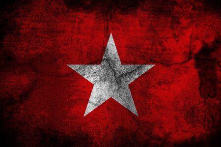 anti fascist: Flag of the anti-fascist movement over a grunge background