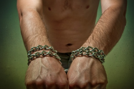 Male hands with chain wrapped around them, prisoner concept Stock Photo - 13299225