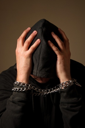 Male hands with chain wrapped around them, prisoner concept Stock Photo - 13299212