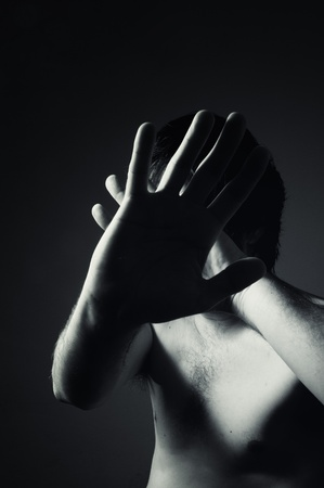 Naked man defending himself, image can be used for domestic violence concept Stock Photo - 13299189