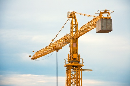 tower crane: Yellow construction crane on a cold, cloudy day  Stock Photo