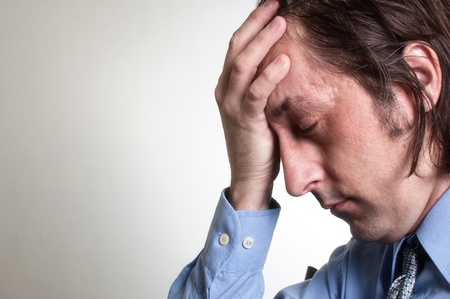 Adult businessman with a terrible headache, painful grimace. Stock Photo - 13359238