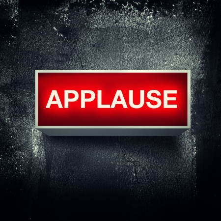 music production:  Applause  warning board message is lit on  Stock Photo