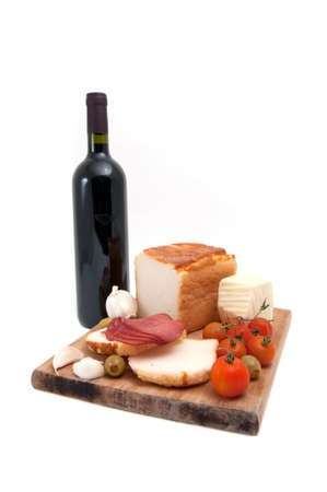 bootle: Gluten free bread with olive, red cherry tomato, garlic, cheese, sliced red smoked meat and a bootle of red wine. Stock Photo