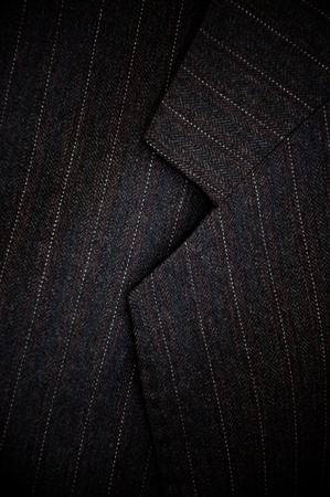 coat and tie: Close up detail of a gray business suit