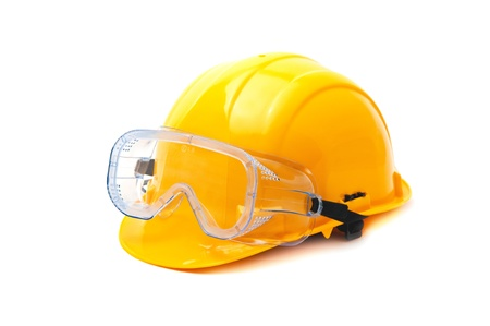 Yellow hard hat and protective plastic goggles, protective equipment in construction industry  photo